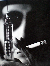 Still from the film Chappaqua showing William Burroughs with hypodermic and cigarette