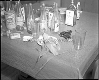 Table Littered with Bottles and the Murder Weapon