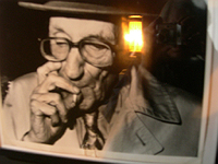 Dreamachine reflected in photo of Burroughs