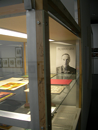 Gatewood photo of Burroughs in vitrine