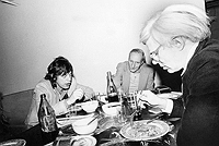 Mick Jagger, William Burroughs, and Andy Warhol at dinner